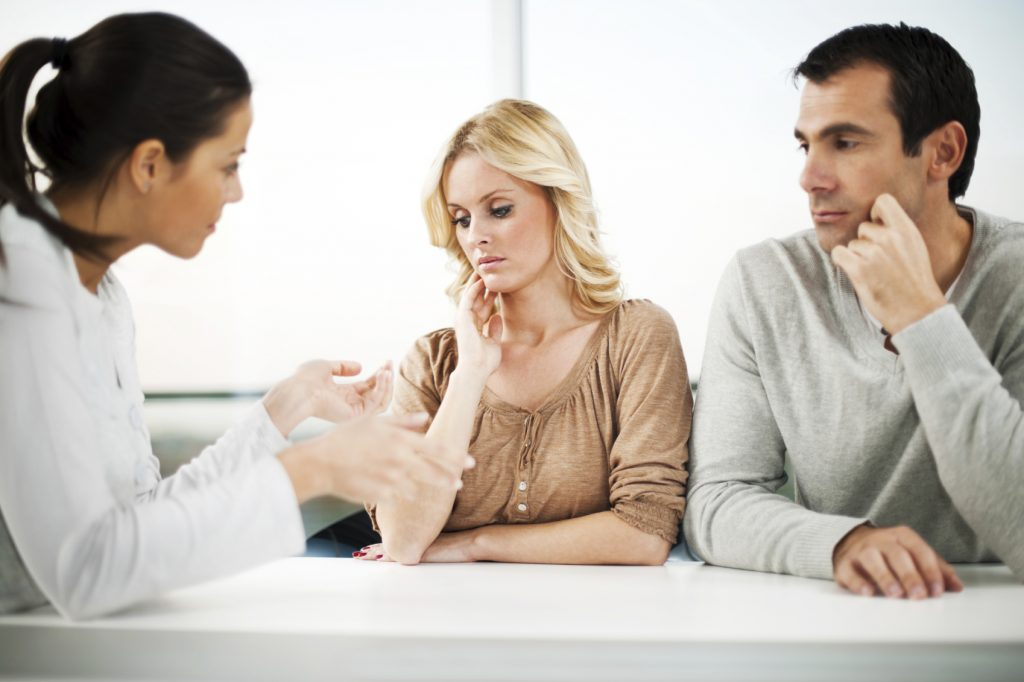 Divorce. Unhappy couple at the marriage counselor. [url=http://www.istockphoto.com/search/lightbox/9786786][img]http://dl.dropbox.com/u/40117171/couples.jpg[/img][/url] [url=http://www.istockphoto.com/search/lightbox/9786778][img]http://dl.dropbox.com/u/40117171/family.jpg[/img][/url]